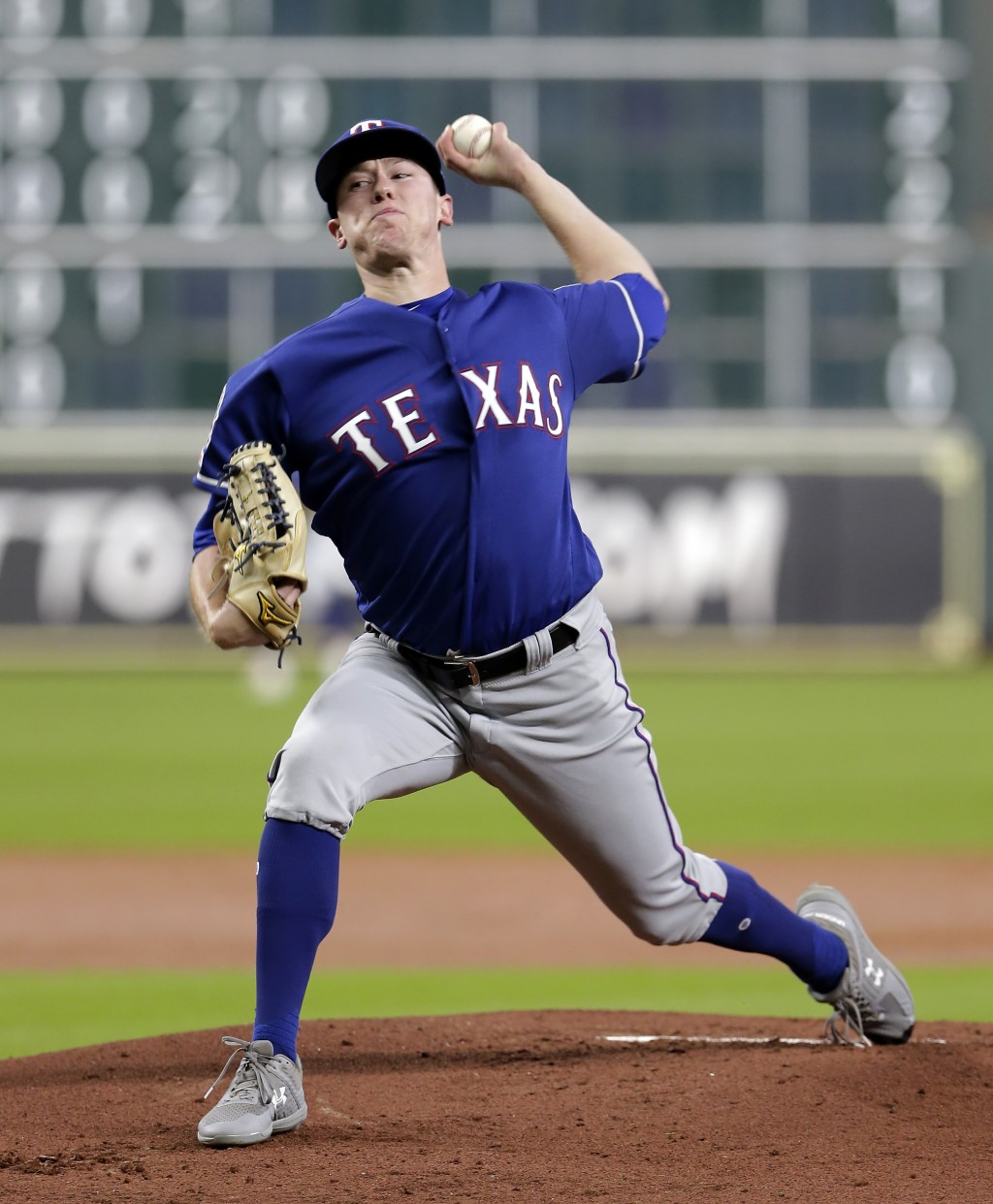 Texas Rangers starting pitcher Kolby Allard throws against the Houston Astros during the first inning of a baseball game Wednesday, Sept. 18, 2019, in...
