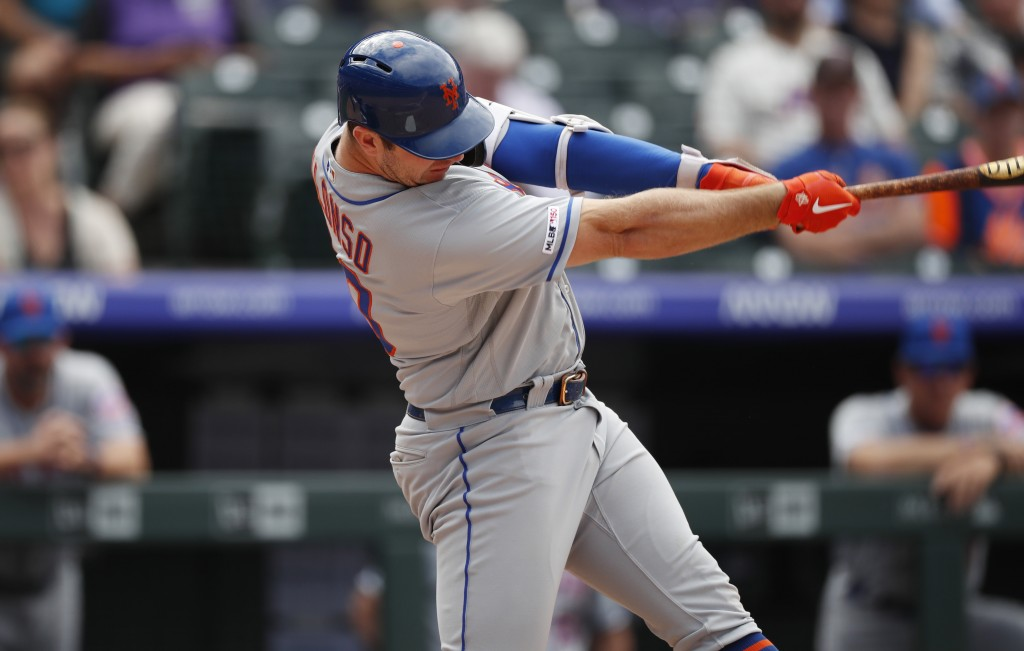 New York Mets' Pete Alonso connects for a solo home run off Colorado Rockies starting pitcher Jeff Hoffman in the sixth inning of a baseball game Wedn...