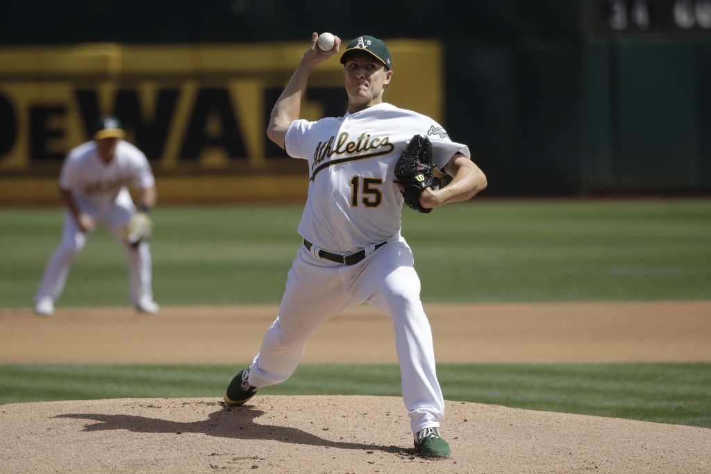Oakland Athletics pitcher Homer Bailey throws to a Kansas City Royals batter during the first inning of a baseball game in Oakland, Calif., Wednesday,...