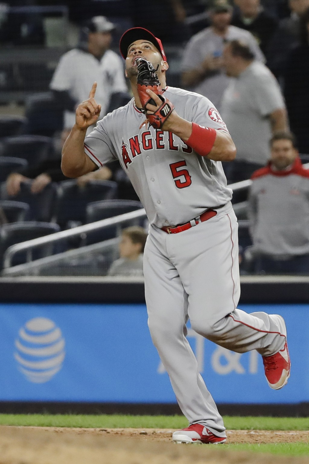 Los Angeles Angels first baseman Albert Pujols celebrates after the Angels' 3-2 win in a baseball game against the New York Yankees on Wednesday, Sept