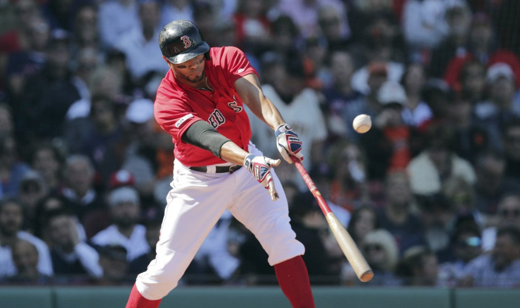Boston Red Sox's Xander Bogaerts connects for a two RBI single during the second inning of a baseball game against the San Francisco Giants at Fenway ...