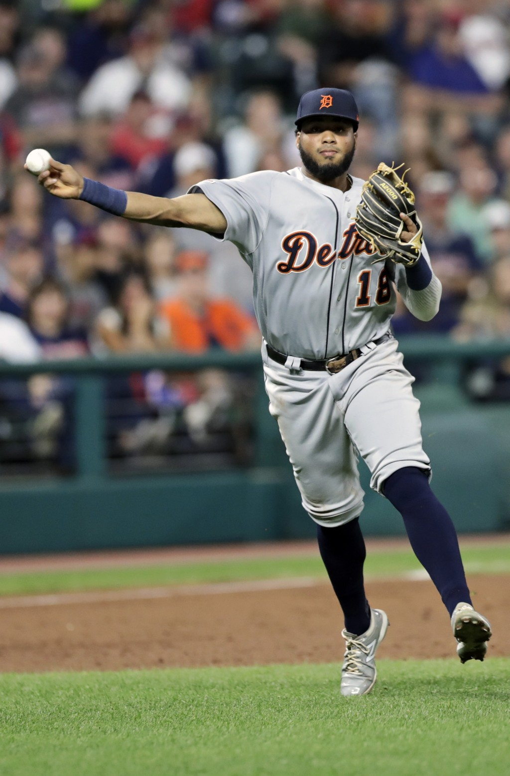 Detroit Tigers' Dawel Lugo throws to first base but not in time to get Cleveland Indians' Francisco Lindor in the third inning in a baseball game Thur...