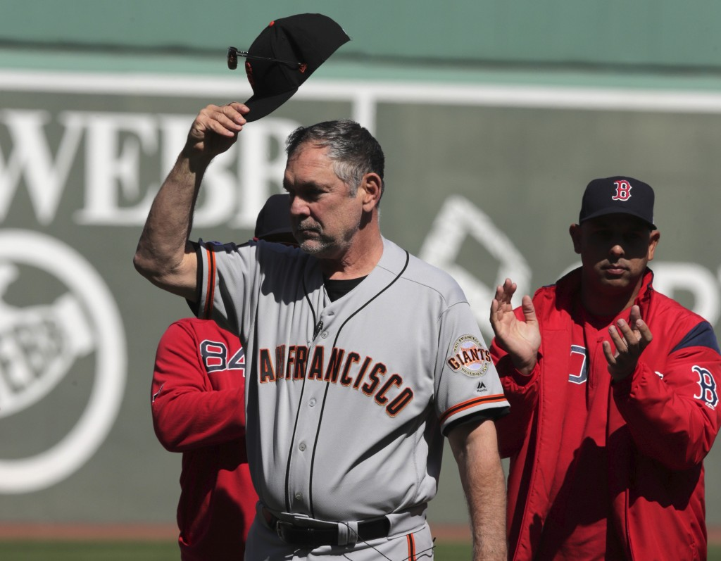 San Francisco Giants manager Bruce Bochy tips his cap as he is honored prior to a baseball game against the Boston Red Sox at Fenway Park in Boston, T...