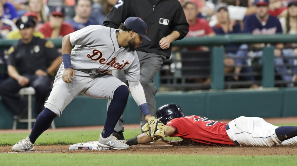Cleveland Indians' Oscar Mercado, right, steals third base as Detroit Tigers' Dawel Lugo is late on the tag in the fifth inning in a baseball game Thu...