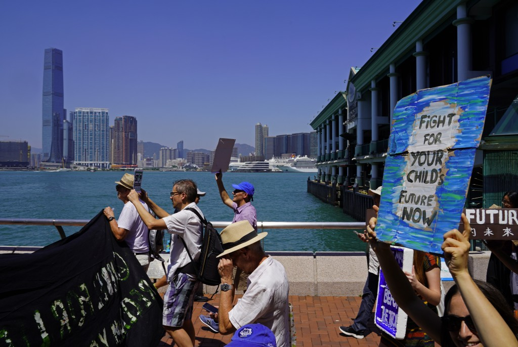 Protesters with placards participate in the Global Strike 4 Climate rally in Hong Kong, Friday, Sept. 20, 2019. Protesters are gathering as a day of w