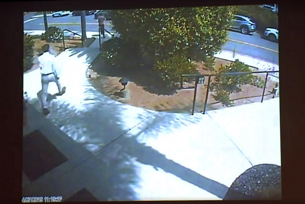 This April 27, 2019 photo from surveillance video at the Chabad of Poway, shown as evidence in the preliminary hearing of John T. Earnest, shows what