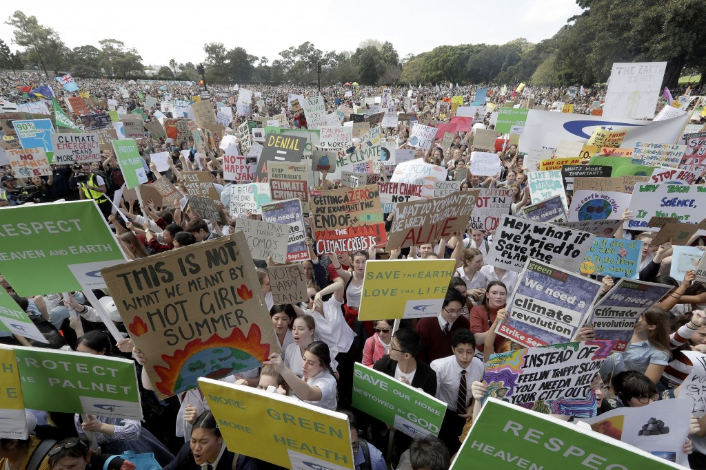 Thousands of protestors, many of them school students, gather in Sydney, Friday, Sept. 20, 2019, calling for action to guard against climate change. A