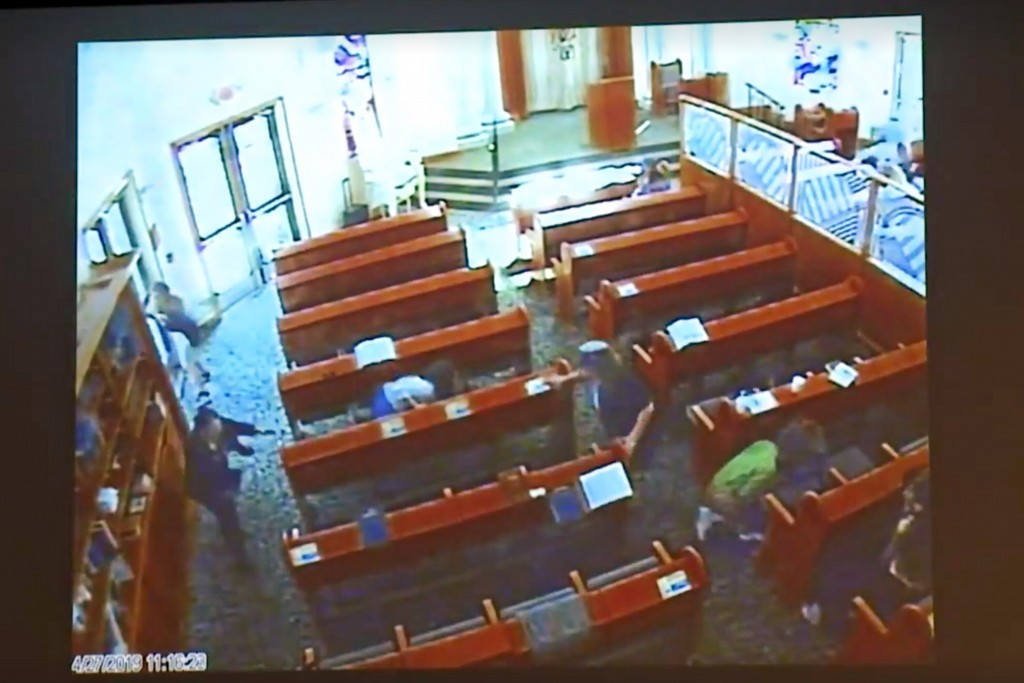 This April 27, 2019 photo from surveillance video at the Chabad of Poway, shown as evidence in the preliminary hearing of John T. Earnest, shows peopl