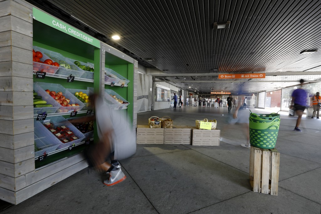 In this Tuesday, Aug. 20, 2019 photo, people pass by the Fresh MARTA Market in the West End transit station in Atlanta. The Metropolitan Atlanta Rapid