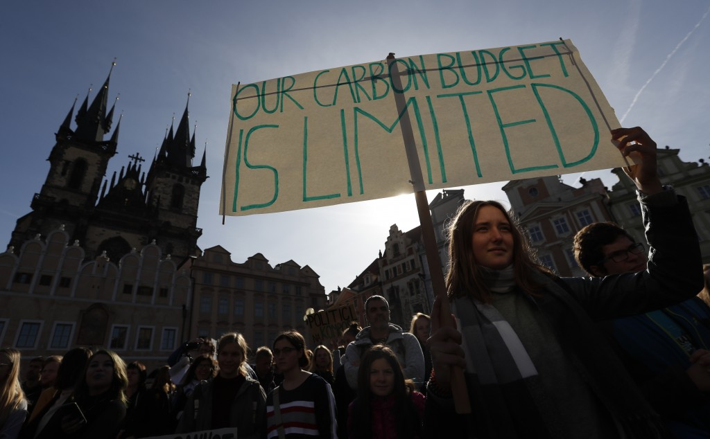 A girl holds a sign during a protest at the Old Town Square in Prague, Czech Republic, Friday, Sept. 20, 2019. Several hundreds of protestors gathered