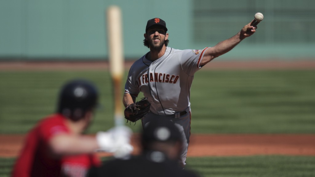 San Francisco Giants starting pitcher Madison Bumgarner delivers during the first inning of a baseball game against the Boston Red Sox at Fenway Park ...