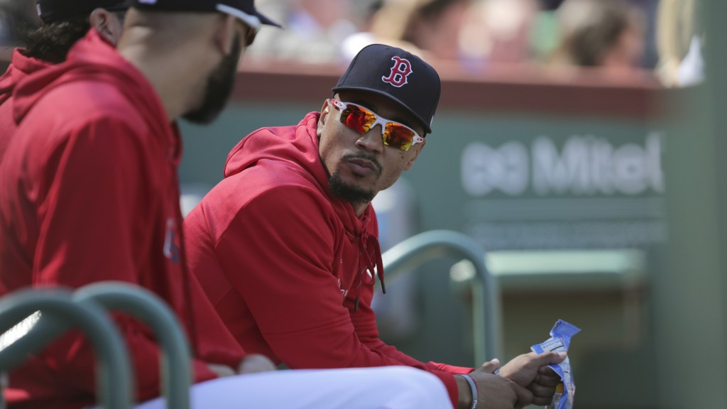 Boston Red Sox right fielder Mookie Betts, right, talks with pitcher David Price during the second inning of a baseball game against the San Francisco...