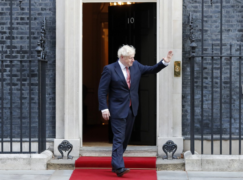 Britain's Prime Minister Boris Johnson waves to welcome the Emir of Qatar, Sheikh Tamim bin Hamad Al Thani at 10 Downing Street in London, Friday, Sep...
