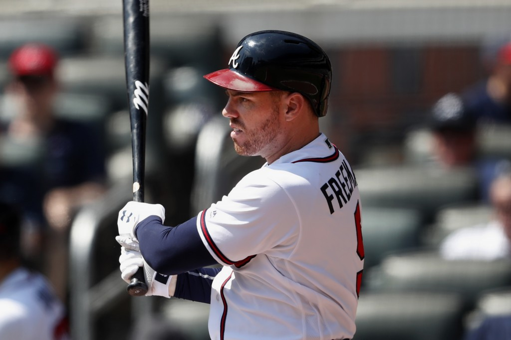 Atlanta Braves first baseman Freddie Freeman drives in two runs with a base hit in the fifth inning of a baseball game against the Philadelphia Ph