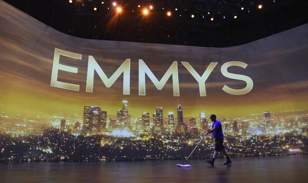 Crew member Brent Tillema sweeps the stage during Press Preview Day for the 71st Primetime Emmy Awards, Thursday, Sept. 19, 2019, at the Microsoft The...