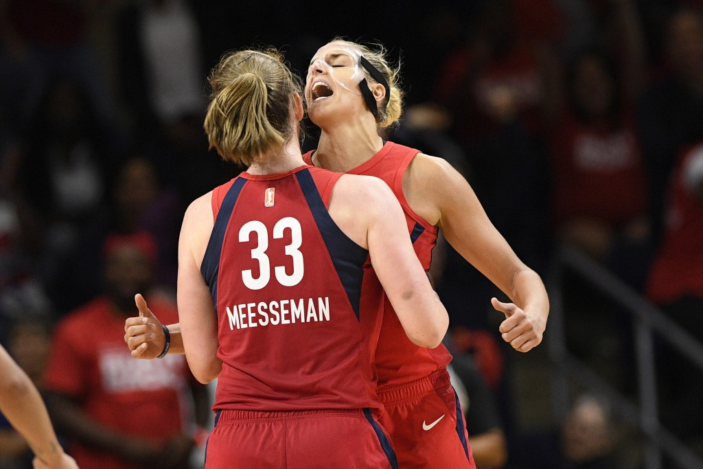 Washington Mystics center Emma Meesseman (33) and Elena Delle Donne, back reacts during the second half of Game 2 of a WNBA playoff basketball series ...