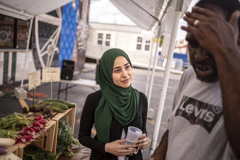 In this Monday, Aug. 19, 2019, photo, dietitian Heba Abdel Latief, right, talks to her patient, Richard Ware, at Inner-city Muslim Action Network's (I...