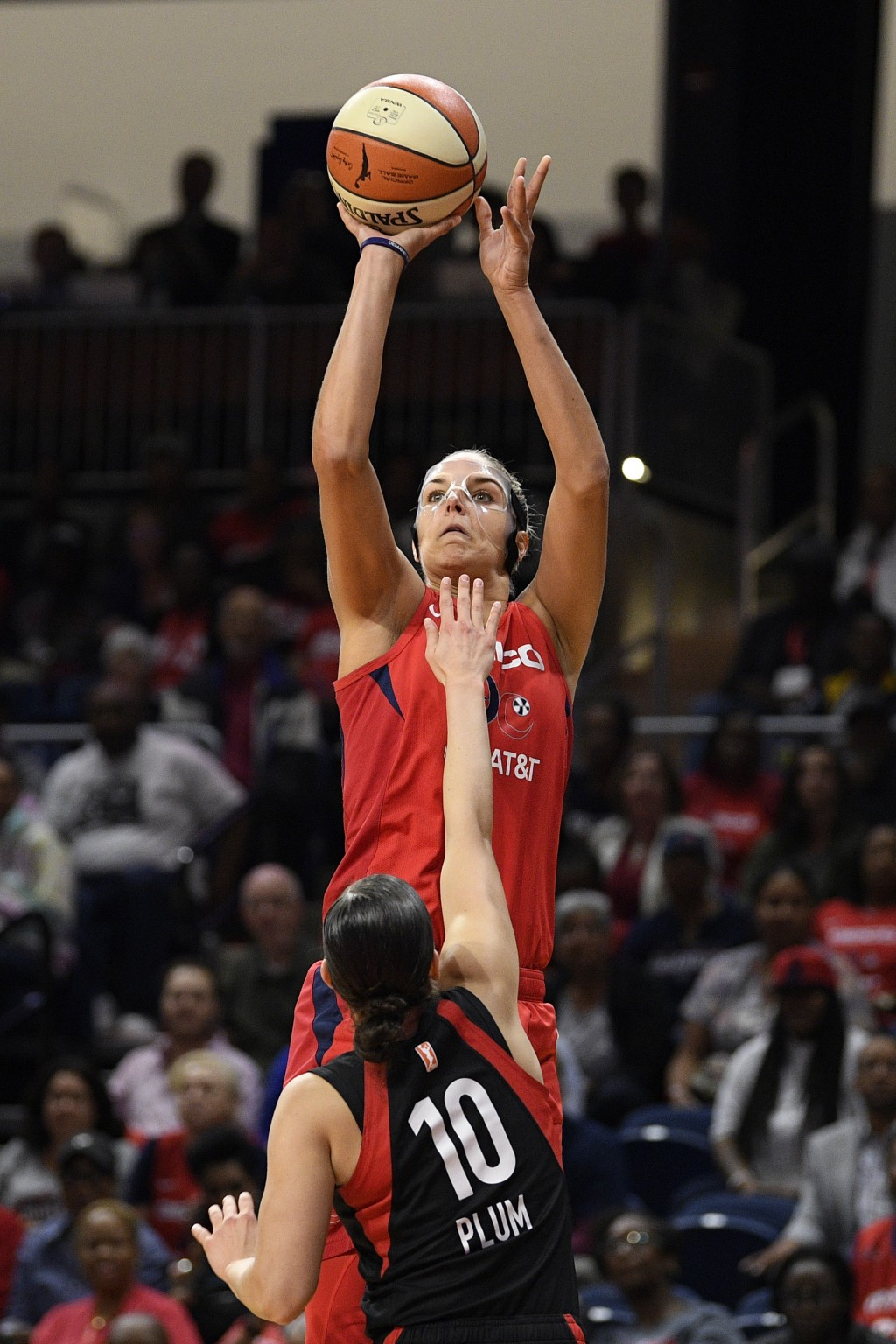 Washington Mystics forward Elena Delle Donne shoots over Las Vegas Aces guard Kelsey Plum (10) during the first half of Game 2 of a WNBA playoff baske...