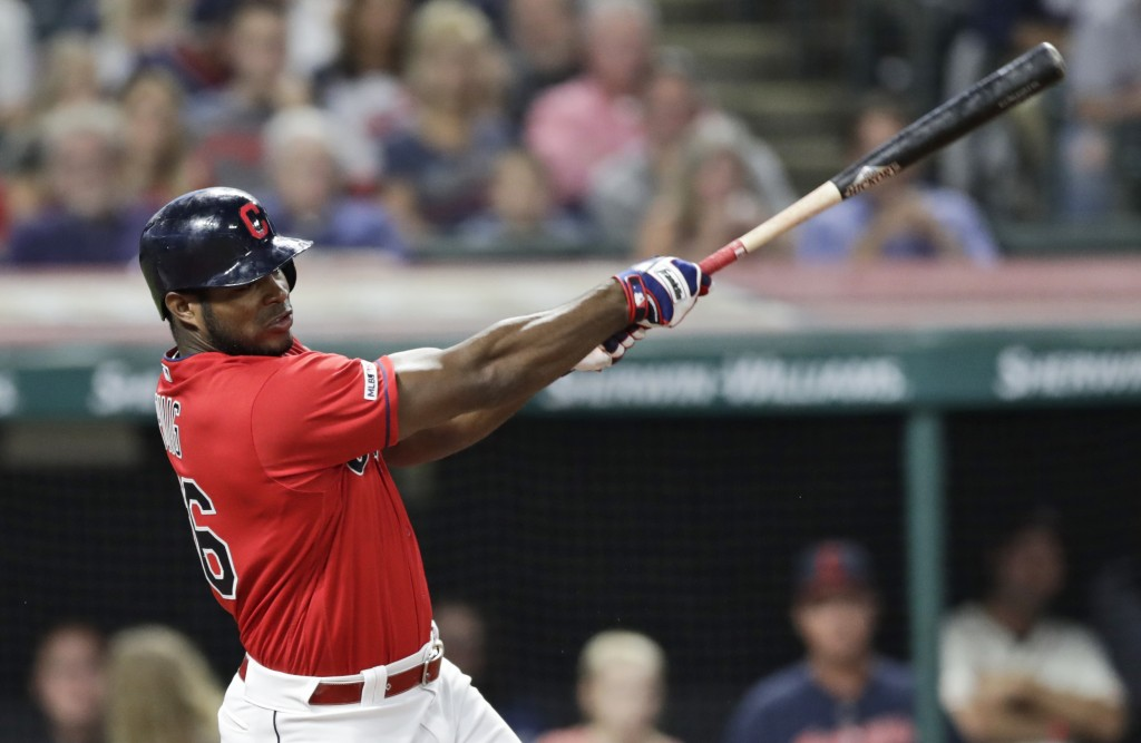Cleveland Indians' Yasiel Puig hits a one-run double in the fourth inning in a baseball game against the Detroit Tigers, Thursday, Sept. 19, 2019, in ...
