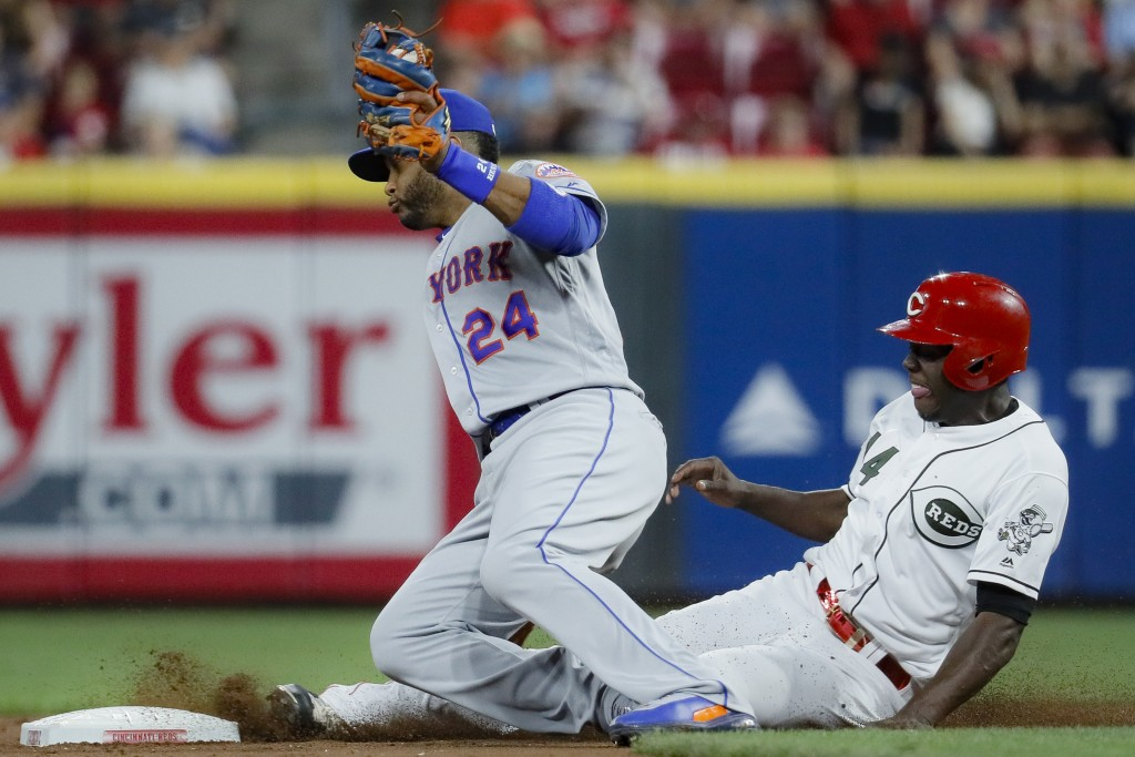 Cincinnati Reds' Aristides Aquino, right, steals second against New York Mets second baseman Robinson Cano (24) in the fourth inning of a baseball gam...