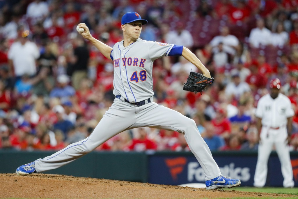 New York Mets starting pitcher Jacob deGrom throws in the second inning of a baseball game against the Cincinnati Reds, Friday, Sept. 20, 2019, in Cin...