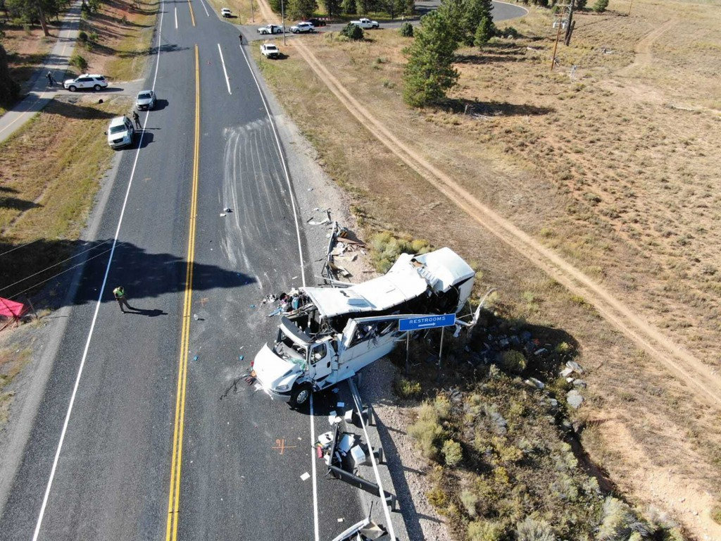 This photo provided by the Utah Highway Patrol shows a tour bus carrying Chinese-speaking tourists after it crashed near Bryce Canyon National Park in...