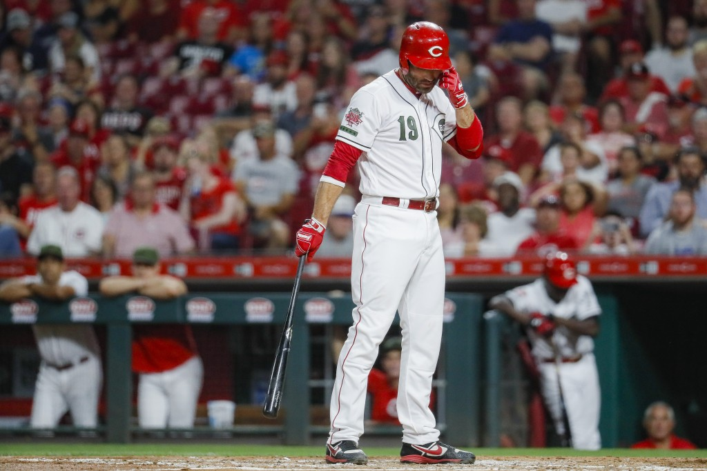 Cincinnati Reds' Joey Votto reacts after striking out against New York Mets starting pitcher Jacob deGrom to close the third inning of a baseball game...