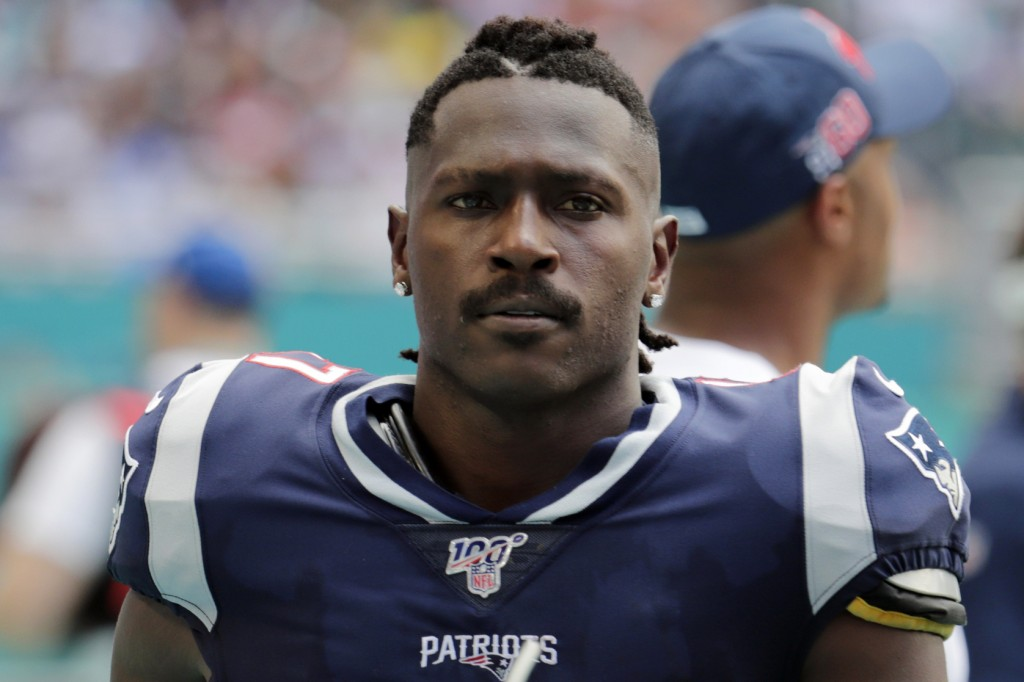 FILE - In this Sunday, Sept. 15, 2019, file photo, New England Patriots wide receiver Antonio Brown (17) on the sidelines,during the first half at an ...