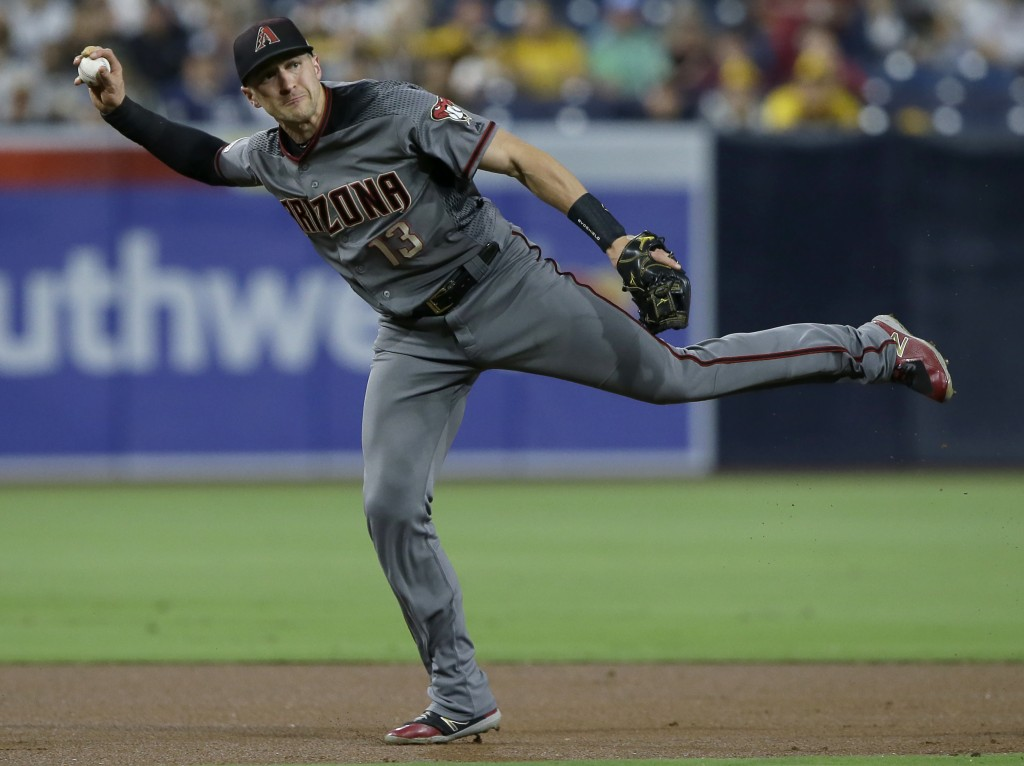 Arizona Diamondbacks shortstop Nick Ahmed throws out San Diego Padres' Greg Garcia on a ground ball during the first inning of a baseball game in San ...