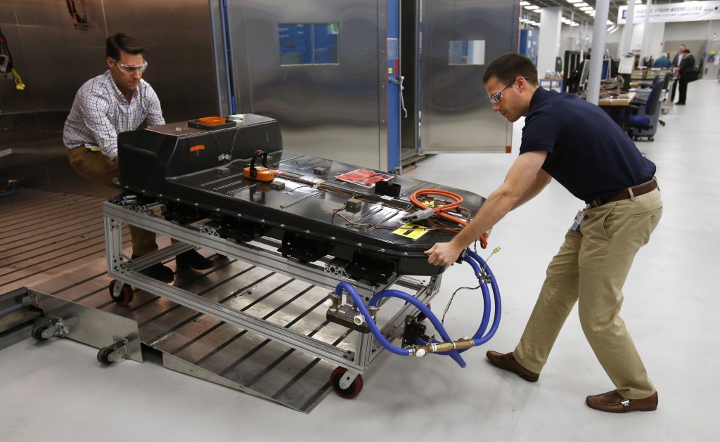 FILE- In this Nov. 4, 2016, file photo, a Chevrolet Bolt EV battery pack is removed for testing after undergoing charging and discharging cycles at Ge...