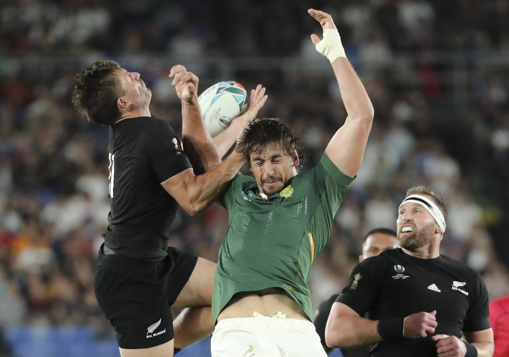 New Zealand's George Bridge, left, taps the ball against South Africa's Eben Etzebeth during the Rugby World Cup Pool B game at International Stadium ...