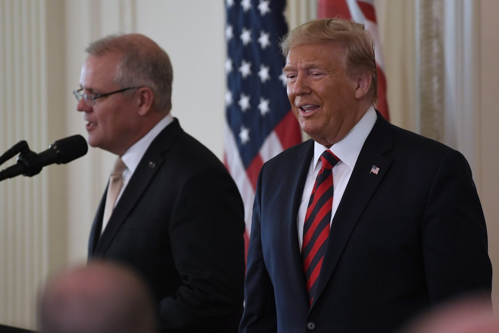 President Donald Trump and Australian Prime Minister Scott Morrison arrive for a news conference in the East Room of the White House in Washington, Fr...