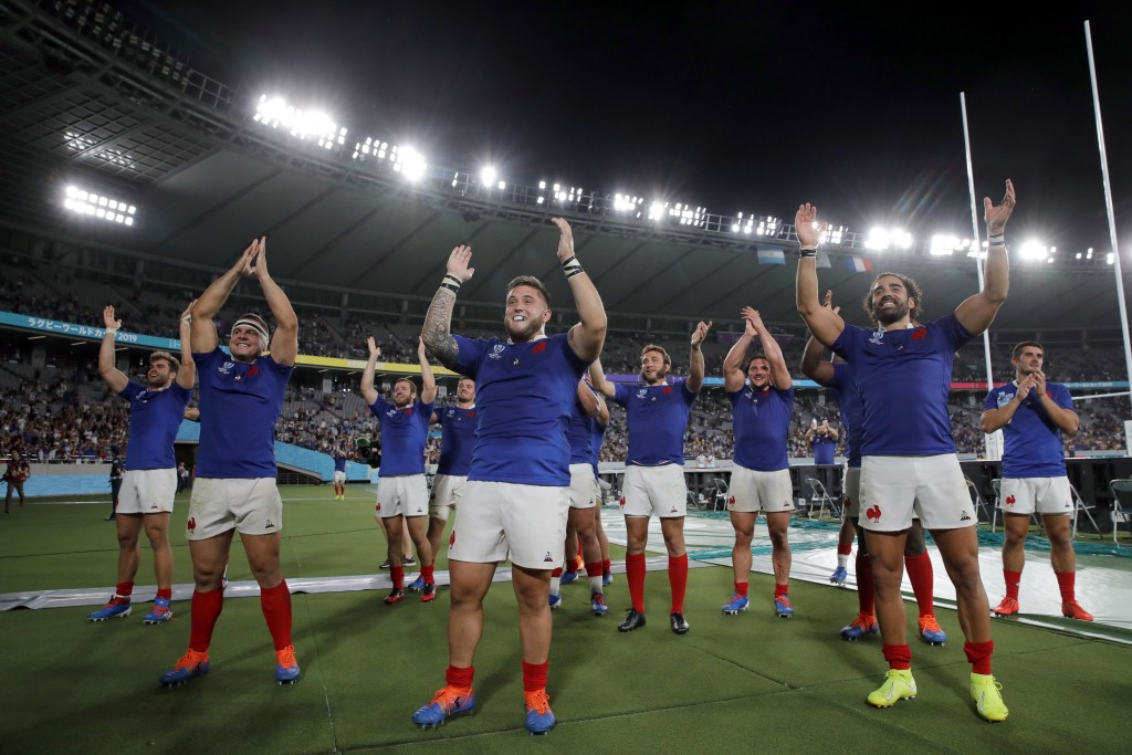 French rugby players celebrate after defeating Argentina during the Rugby World Cup Pool C game at Tokyo Stadium between France and Argentina in Tokyo...