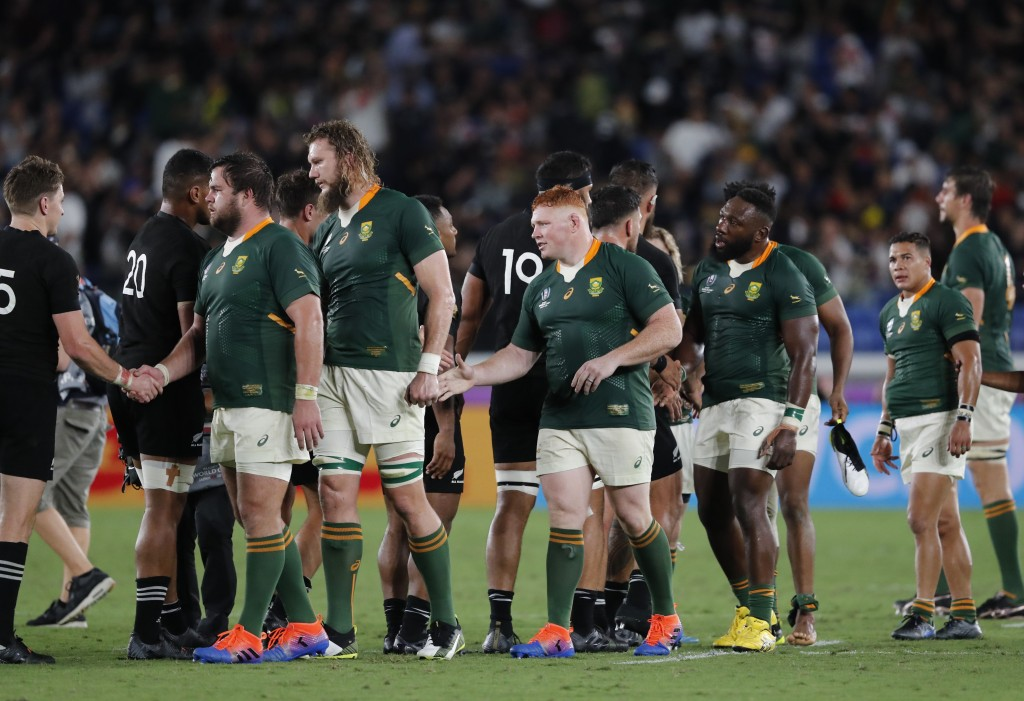 New Zealand and South African players greet each other at the end of the Rugby World Cup Pool B game in Yokohama, Japan, Saturday, Sept. 21, 2019. (AP...