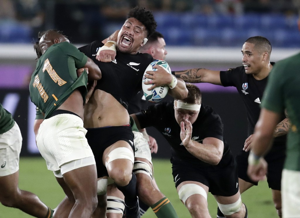 New Zealand's Ardie Savea reacts as he is tackled by South Africa's Makazole Mapimpi, left, during the Rugby World Cup Pool B game at International St...