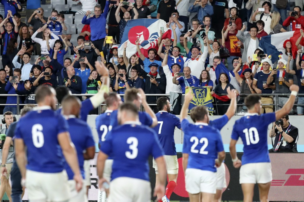 Fans for France team cheer after the Rugby World Cup Pool C game at Tokyo Stadium between France and Argentina in Tokyo, Japan, Saturday, Sept. 21, 20...