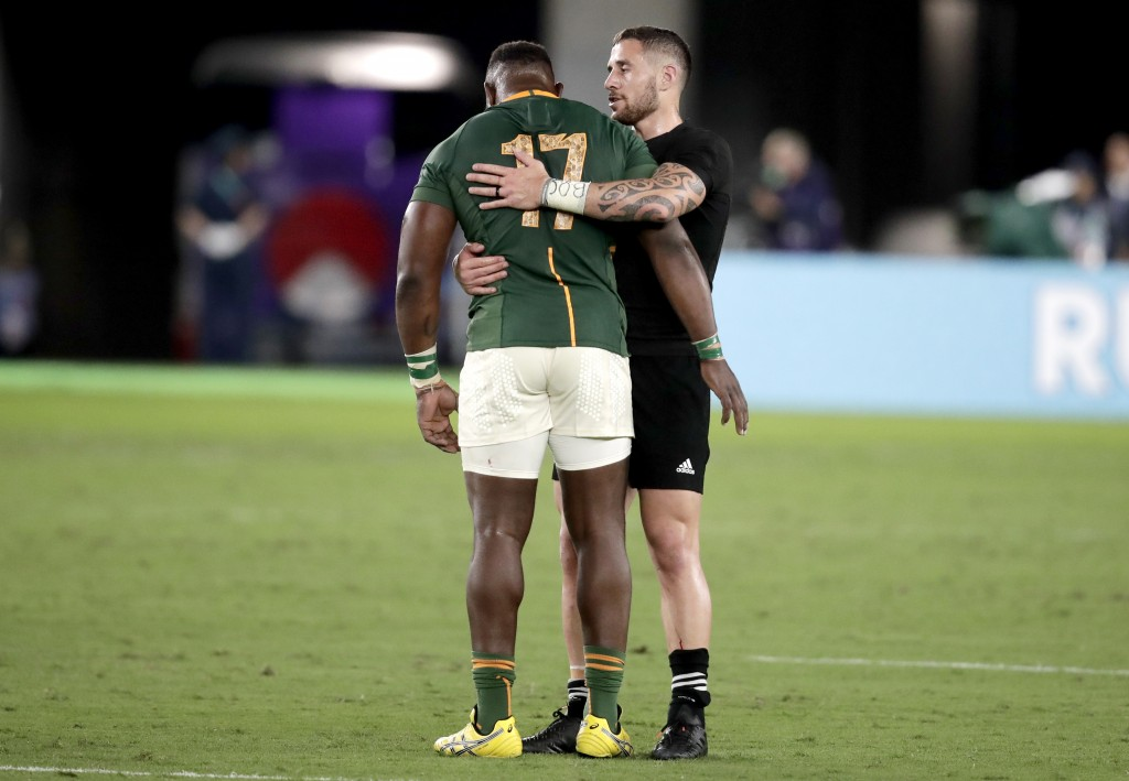 New Zealand's TJ Perenara embraces South Africa's Tendai Mtawarira following their Rugby World Cup Pool B game at International Stadium between New Ze...