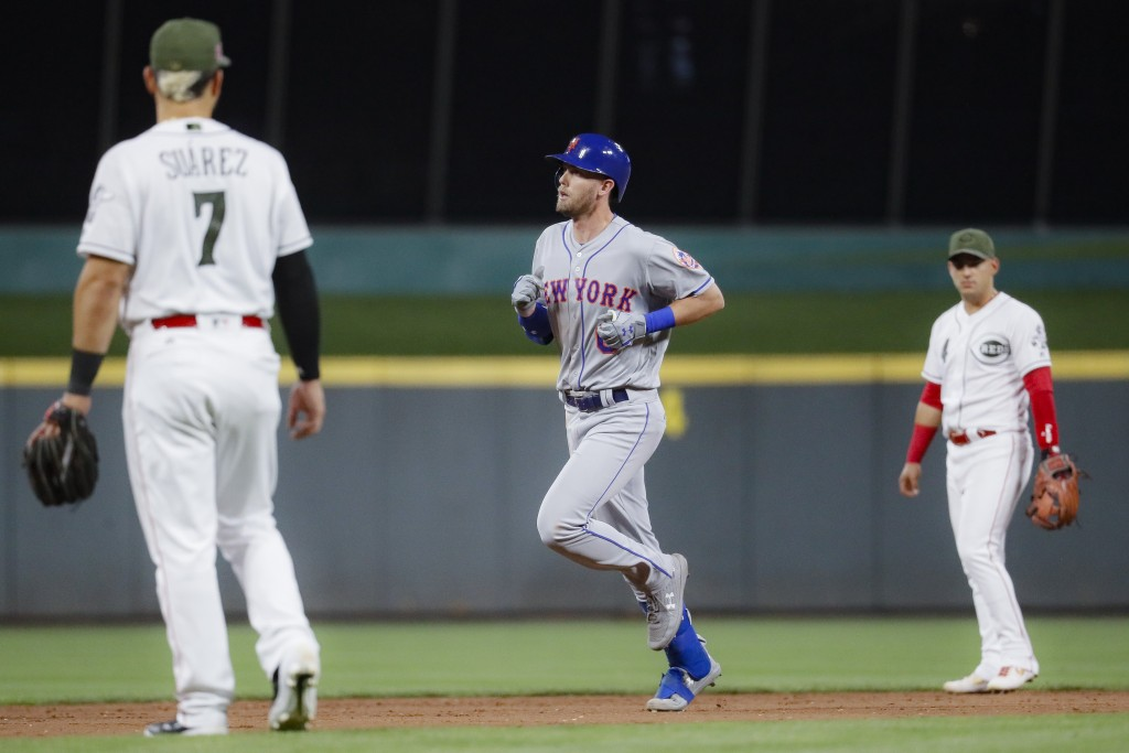 New York Mets' Jeff McNeil runs the bases after hitting a solo home run off Cincinnati Reds starting pitcher Luis Castillo in the sixth inning of a ba...