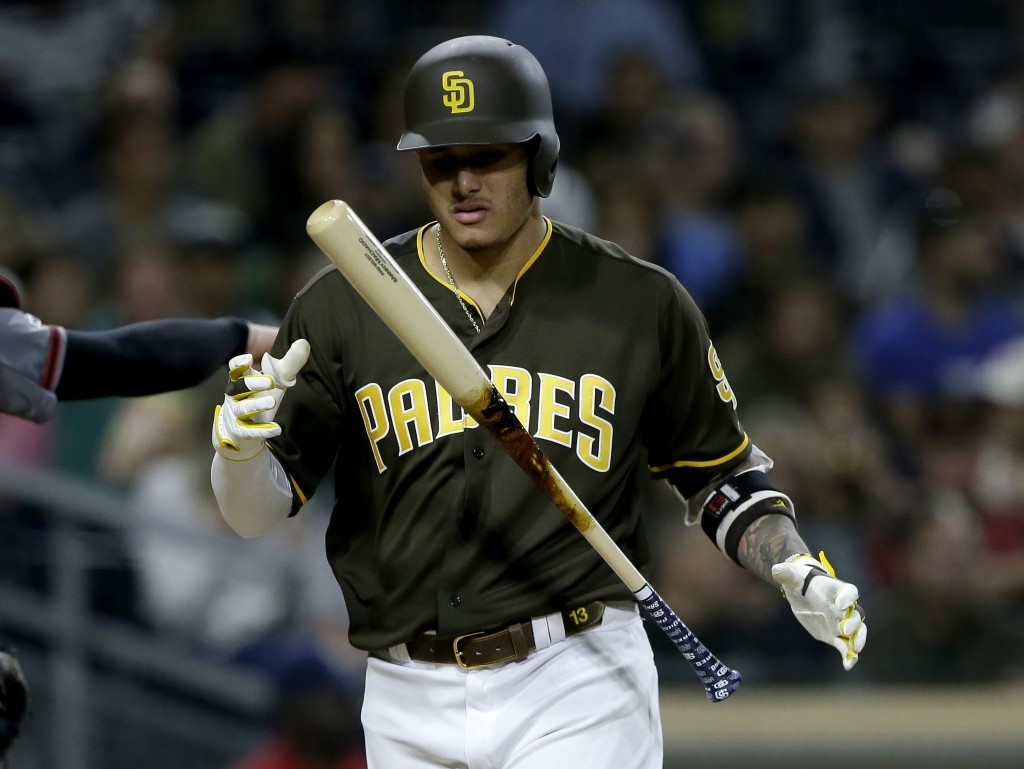 San Diego Padres' Manny Machado juggles his bat after striking out during the fourth inning of the team's baseball game against the Arizona Diamondbac...