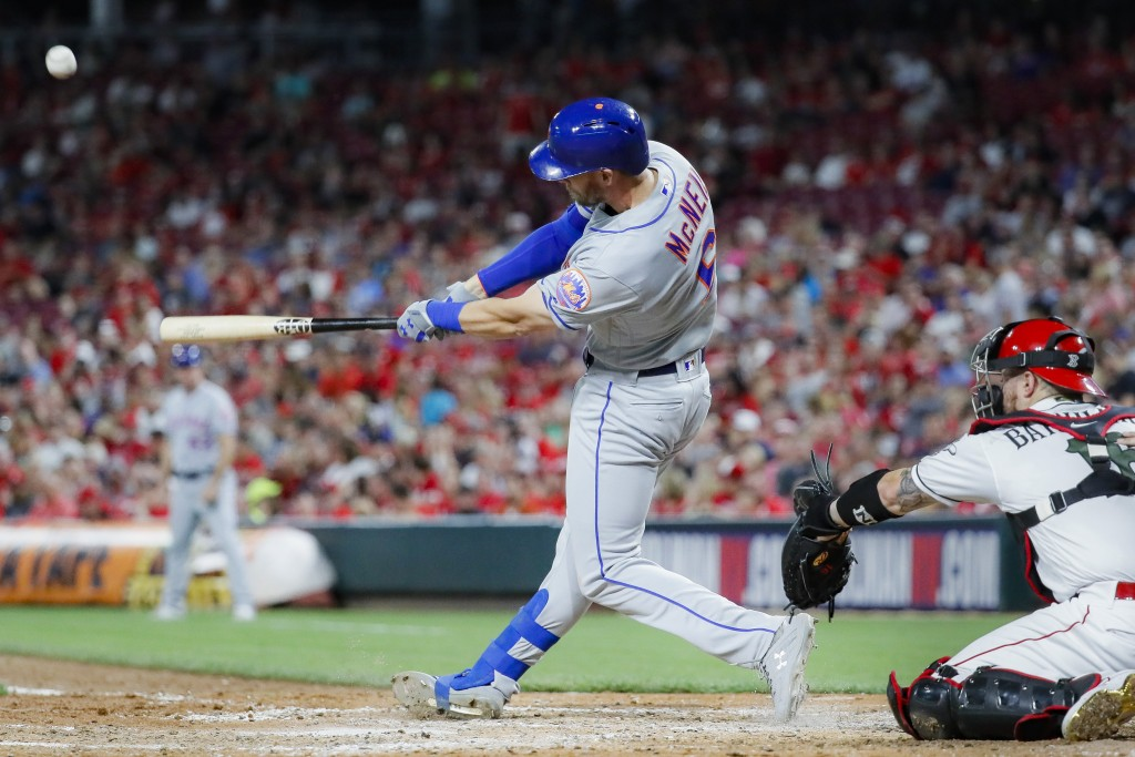 New York Mets' Jeff McNeil hits a solo home run off Cincinnati Reds starting pitcher Luis Castillo in the sixth inning of a baseball game Friday, Sept...