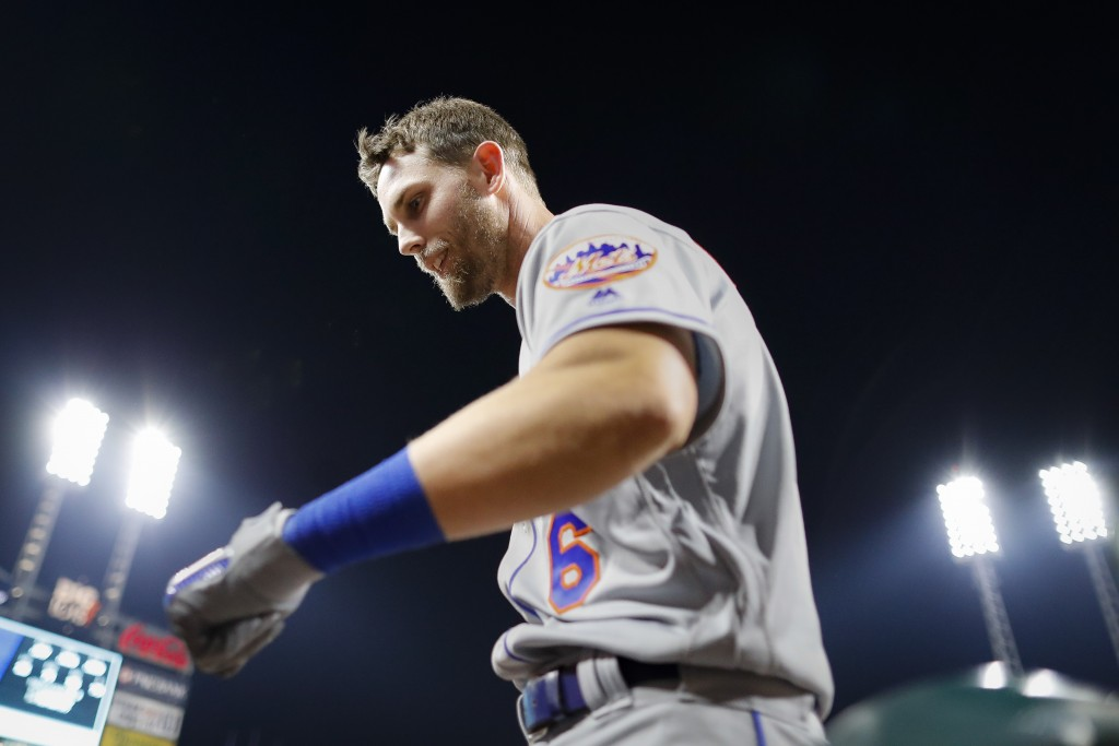 New York Mets' Jeff McNeil celebrates after hitting a solo home run off Cincinnati Reds starting pitcher Luis Castillo in the sixth inning of a baseba...