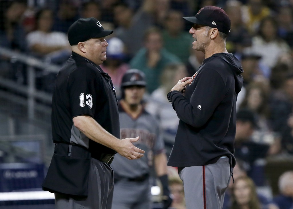 Arizona Diamondbacks manager Torey Lovullo, right, argues with home plate umpire Todd Tichenor during the seventh inning of the team's baseball game a...