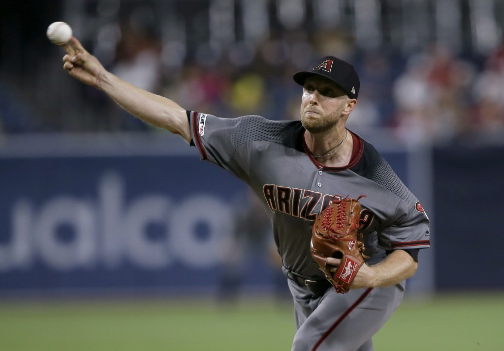 Arizona Diamondbacks starting pitcher Merrill Kelly throws to a San Diego Padres batter during the first inning of a baseball game in San Diego, Frida...