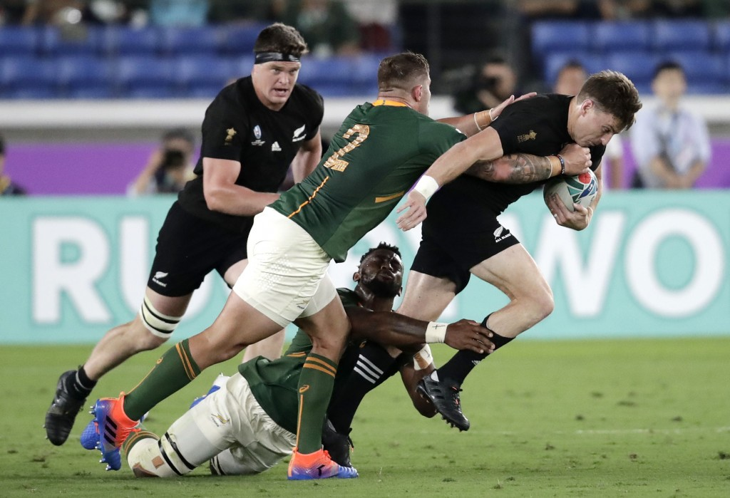 New Zealand's Beauden Barrett, right, attempts to break the tackle of South Africa's Malcolm Marx during the Rugby World Cup Pool B game at Internatio...