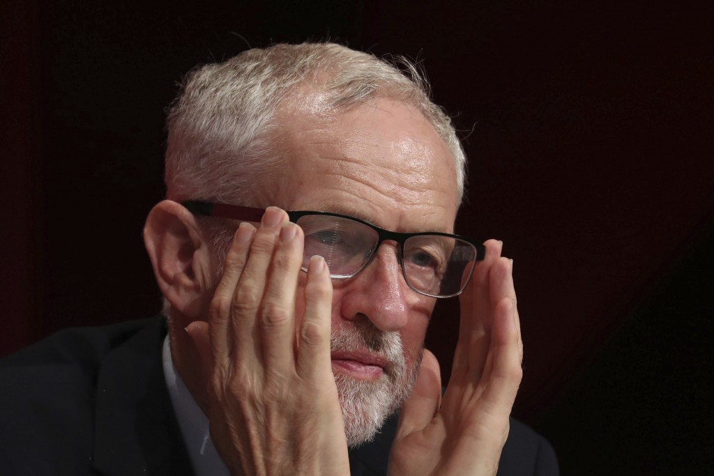 Britain's opposition party leader Jeremy Corbyn on stage during the Labour Party Conference at the Brighton Centre in Brighton, England, Saturday Sept
