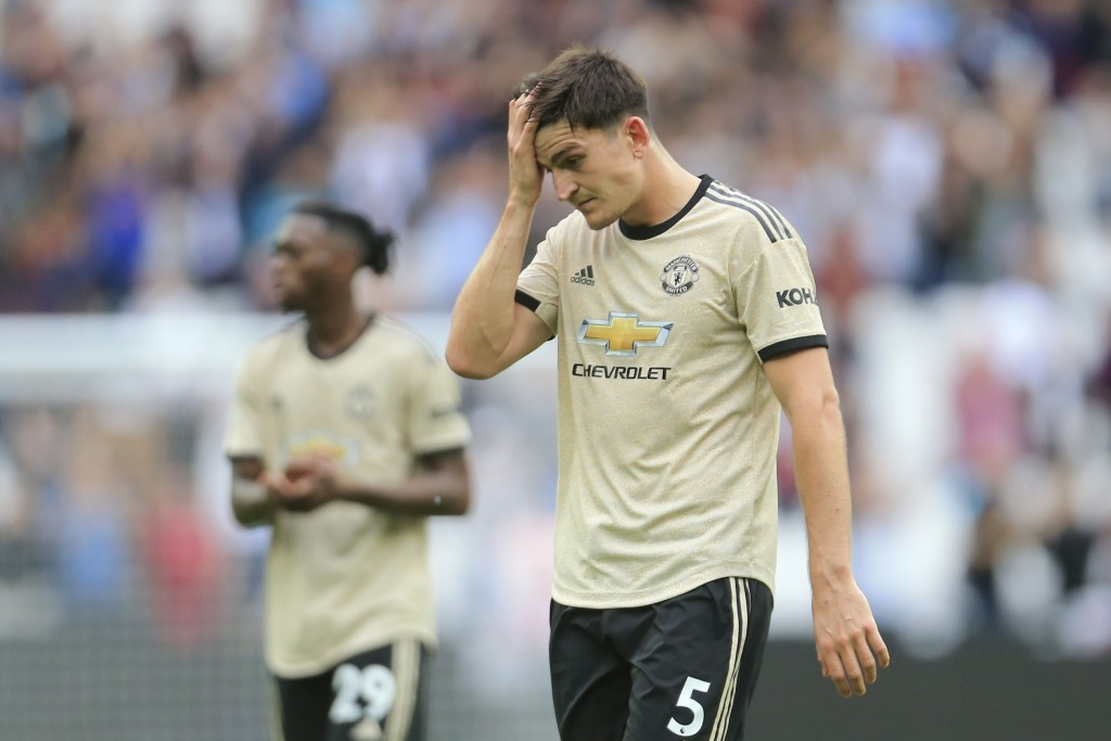 Manchester United's Harry Maguire touches his forehead as he leaves at the end of the English Premier League soccer match between West Ham and Manches