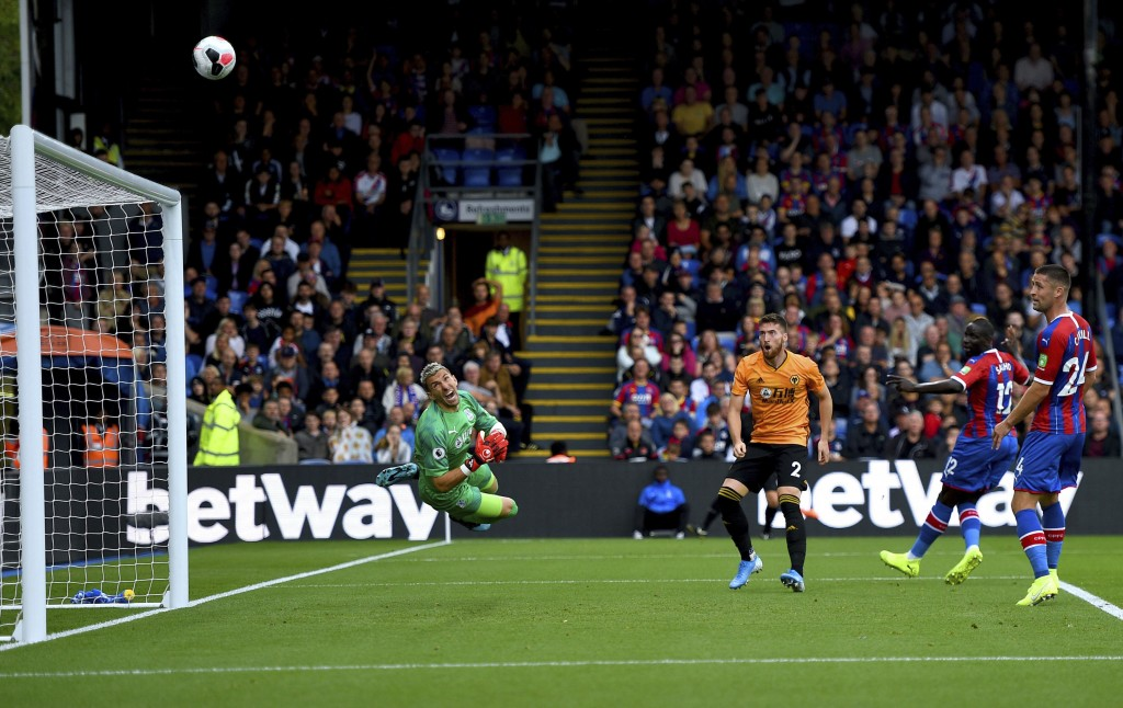 Wolverhampton Wanderers' Matt Doherty (third right) shoots towards the goal but misses during their English Premier League soccer match against Crysta...
