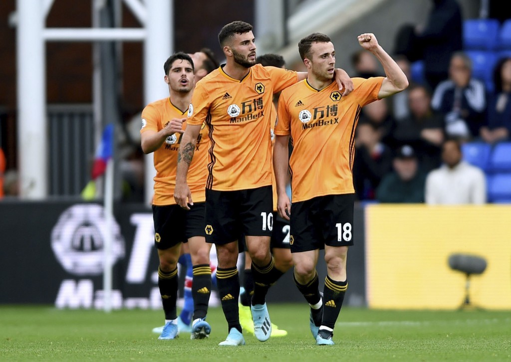 Wolverhampton Wanderers' Diogo Jota, right, celebrates scoring against Crystal Palace's during the English Premier League soccer match at Selhurst Par...