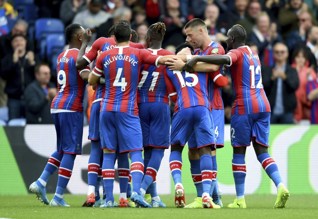 Crystal Palace's Joel Ward celebrates scoring his side's first goal of the game with his team during their English Premier League match against Wolver...