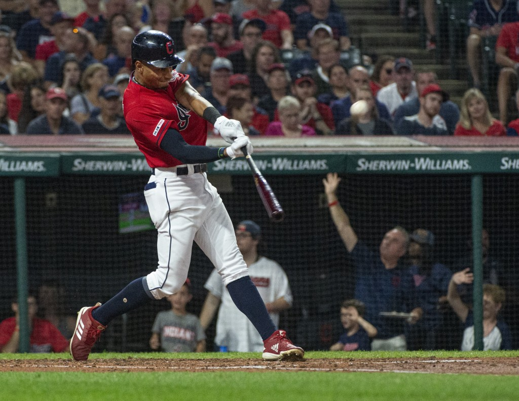 Cleveland Indians' Oscar Mercado hits a two-run home run off Philadelphia Phillies starting pitcher Jason Vargas during the second inning of a basebal
